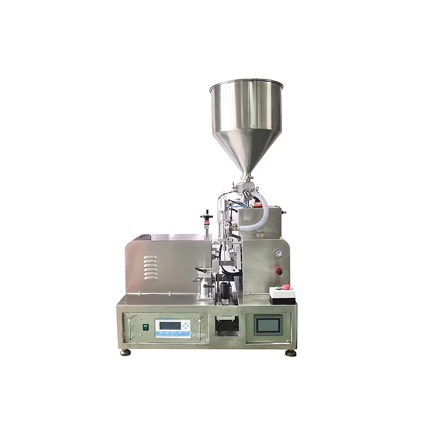 Tube filling and sealing machine with hopper