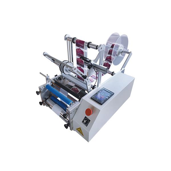 Semi-automatic bottle labelling machine